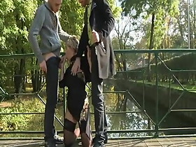 Lisa sucking two guys outdoor while husband filming